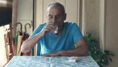 elder man is taking pill at home: disease, illness, care, medicine, therapy, 4k - stock footage