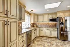 Luxury kitchen interior with back splash trim and tile floor Stock Photos