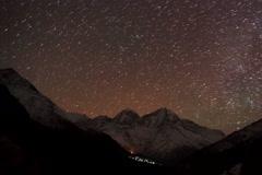 4K. Time lapse of stars behind mountain Kongde Ri Stock Footage
