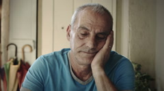 Aged man is thinking about his problems: thoughtful, sad, sadness, loneliness Stock Footage