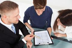 High angle view of financial advisor explaining investment plan to couple at  Stock Photos