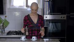 woman cancer survivor prepares coffee at home: relax, life, faith, vitality - stock footage