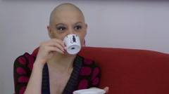 cancer survivor woman drinking coffee at home: relax, life, confidence, vitality - stock footage