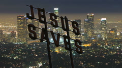 Jesus Saves Christian Sign Over Downtown Los Angeles Night City Stock Footage