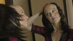 Woman  in  chemotherapy suffering from cancer takes off the wig: loneliness Stock Footage