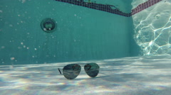 Sun glasses under water summer Stock Footage