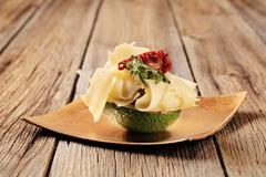 Avocado fruit and slices of swiss cheese Kuvituskuvat
