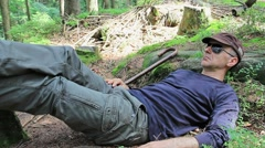 Tired tourist rest in a mountain forest Stock Footage