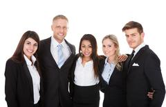 portrait of welldressed businesspeople standing together against white backgr - stock photo
