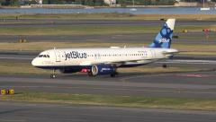 4K JetBlue airplane arrives Stock Footage