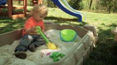 Little Boy In Sandbox - stock footage