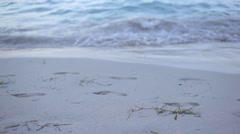 Foot Prints on Beach Shore Line - stock footage