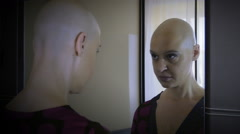 Stock Video Footage of cancer-stricken woman looks in the mirror: loneliness, sadness,  discomfort