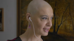 Woman cancer survivor speaking at mobile phone: chemotherapy, bald,  Stock Footage