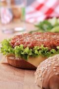 Closeup of a cheeseburger - ready to eat Stock Photos