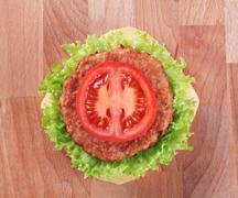 Overhead view of a cheeseburger - closeup Stock Photos