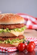double cheeseburger on a red and white napkin - stock photo