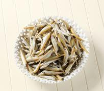 bowl of fresh sprats - overhead - stock photo