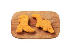 convenience food - dinosaur-shaped breaded nuggets - stock photo