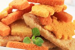 convenience food - breaded fish fingers and nuggets - stock photo