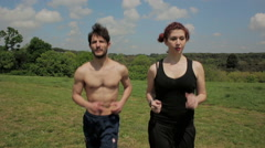 Young people make physical activity running in a park Stock Footage