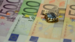 Euro paper money , golden coins and gold jewelery Stock Footage