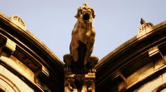 Gargoyle and pigeon - stock photo