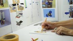 Designer in office drawing new design Stock Footage