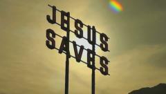 Jesus Christ Saves Sign with Sunrise Sunset Timelapse Stock Footage