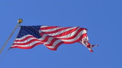 American flag waving over blue sky background, Slow motion. - stock footage