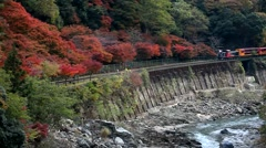 Sagano Romantic Train at Hozu Gorge, Kyoto, Japan Stock Footage