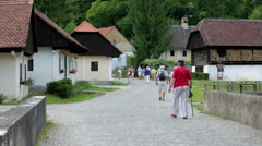 Tourist tour through the historic village Stock Footage