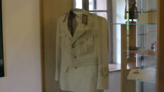 Historical uniforms placed in a display cabinet Stock Footage