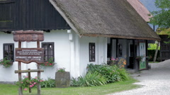 Historic village house with thatched roof Stock Footage