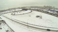 Transport traffic on interchange near city at winter day. Stock Footage