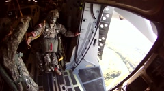 Paratroopers jump from C-17 Globemaster during Arctic Thunder 2014 Airshow - stock footage