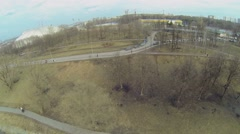 Cityscape with icy pond in park near Locomotive sport complex Stock Footage