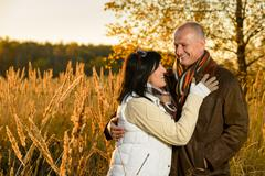 Couple in love hugging in autumn sunset Stock Photos