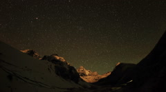 Time lapse of stars behind mountains Kyajo, Pharilapche, Machhermo Glacier Stock Footage
