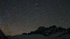 Time lapse of stars behind mountains Pharilapche peak. Nepal Stock Footage