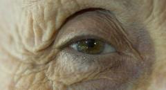 Macro of eye of elderly woman , old eyes ,large wrinkles Stock Footage