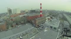 Cityscape with building site of automobile sales centre - stock footage