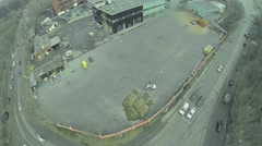 Cars ride by road near building site of automobile sales centre - stock footage