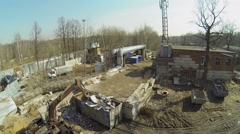 Excavator and containers with trash at garbage plant Stock Footage