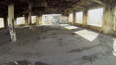 Empty area of neglected burned building at sunny day. Aerial view Stock Footage