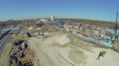 Building site with excavator stands on pile of gravel Stock Footage