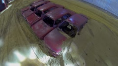 Five car shells form obstacle on sandy autodrome Stock Footage