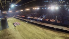 Tribunes with people near autodrome during Show Monster Mania Stock Footage