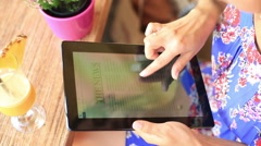 Woman reading news on tablet in the street cafe Stock Footage