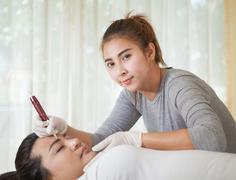 professional permanent makeup applying - stock photo